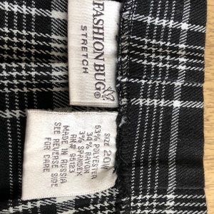 Plaid skirt with side slits. Gently used